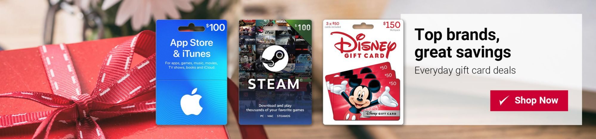 Top brands, great savings, everyday gift card deals. Featured items include $100 App Store & iTunes gift card, $100 Steam gift card, and $150 Disney gift card. Click to shop now.
