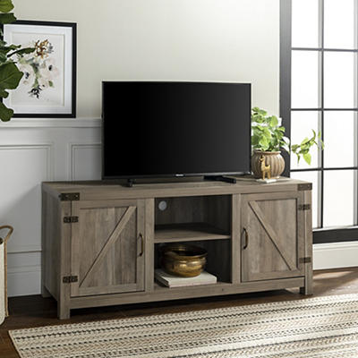 "W. Trends 58"" Barn Door TV Stand with Side Doors - Gray Wash"