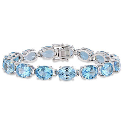 57 ct. t.w. Blue Topaz Tennis Bracelet in Sterling Silver
