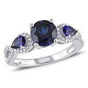 2 1/3 ct. TGW Created Blue Sapphire and 1/6 ct. t.w. 3-Stone Ring in Sterling Silver, Size 7