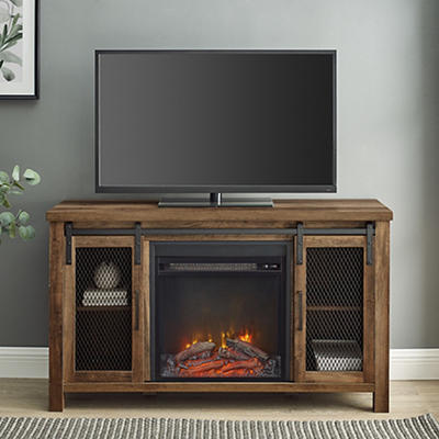 "W. Trends Farmhouse 48"" Sliding Door Fireplace TV Stand - Rustic Oak"