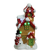 """Northlight 17"""" LED Lighted Snow Covered Cottage Musical Christmas Tabletop Decor - Brown and Red"""