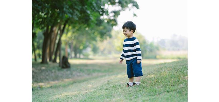 boy age 3 in a field