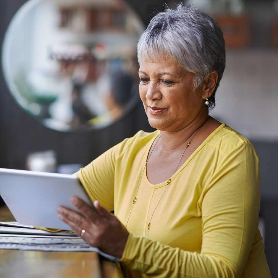 Person reviewing details on tablet